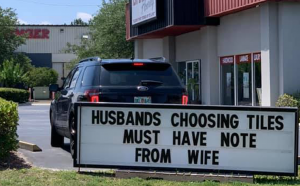 "Sign that reads ""husband choosing tiles must have note from wife"""